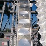 SUNLAB Solar Test Site at Sports Complex parkade rooftop: Fresnel-based CPV module in center