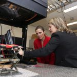 Karin Hinzer introduces Kirsty Duncan to solar cell characterization under a solar simulator